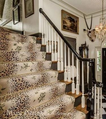 Stunning Stark needlepoint stair runner with leopard and roses print. Accented with a brass stair rod.