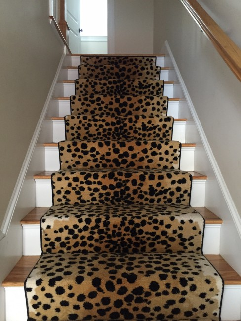 Wool cheetah print stair runner finished with a narrow cotton binding
