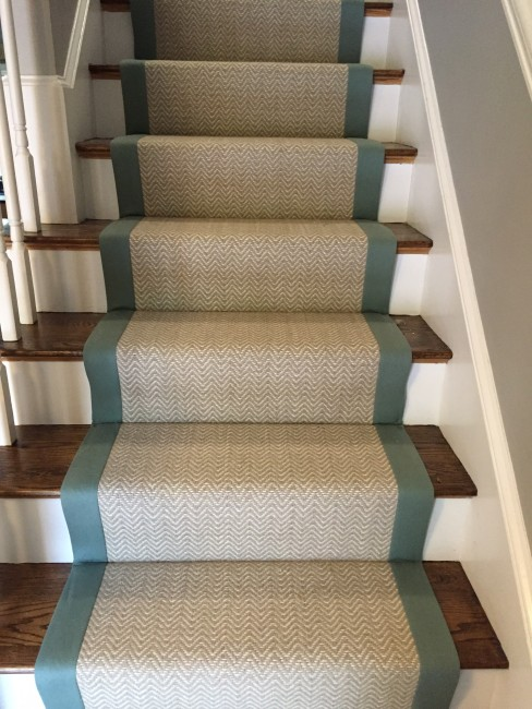 "A wool stair runner bound with a wide cotton tape shows about a 2-3"" wood reveal."