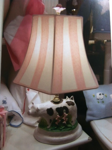 Dana Gibson's Moses Spring ceramic lamp of spotted cow with hand painted pink stripe shade