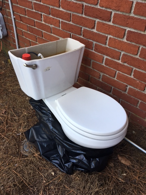 old toilet, now outside of house