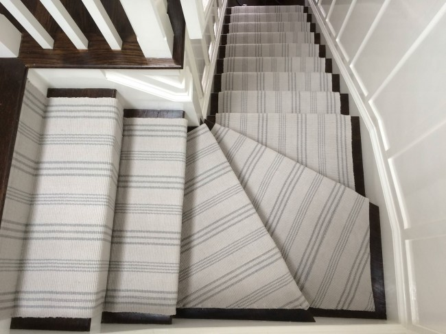 A waterfall application of a woven cotton striped stair runner.